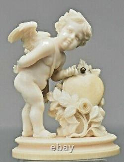 Antique Carved Figurine of Cupid with heart and arrows. Let this be your Angel
