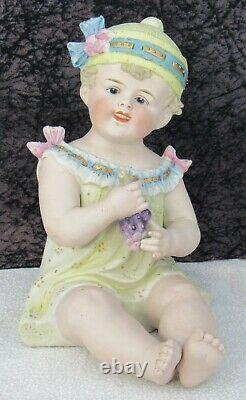 Antique German Bisque Porcelain Piano Baby Figurine Girl with Grapes Heubach